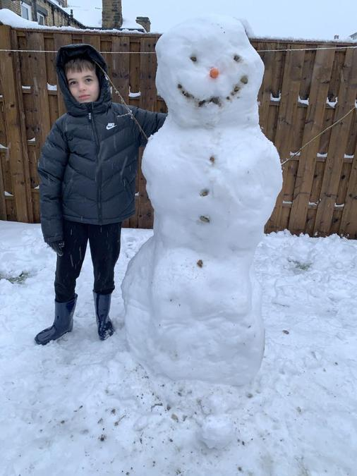 Possibly, our tallest snowman entry Zane!