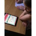Scarlett working hard on fractions in maths!