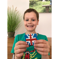 George made a Union Jack from aqua beads.