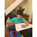 Harry B working hard on our Guided Reading text!