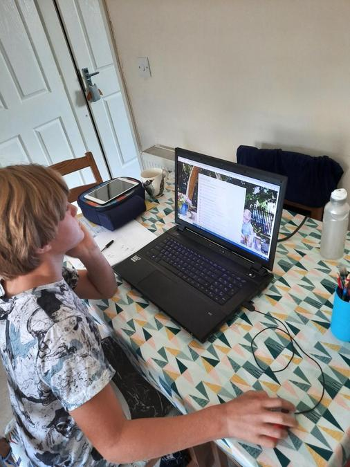 Sam finding his home learning on the website.