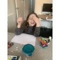 Sophia creating masterpieces.