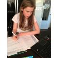 Ellie completing her maths work!