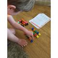 Oliver making equal groups.