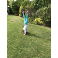 Poppy has perfected the handstand.