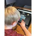 Dylan developing his maths skills.