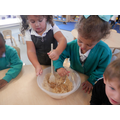 Mixing the ingredients for Gingerbread men