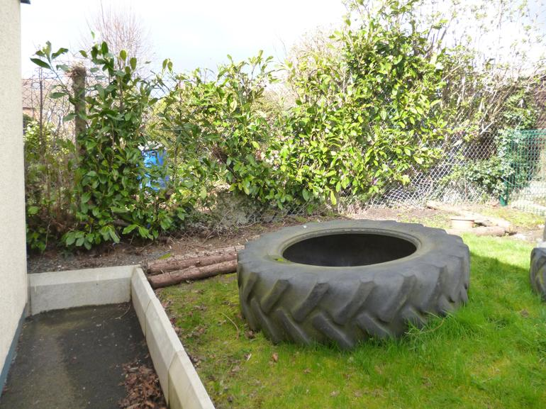 The big tractor tyres are recycled as planters.