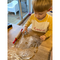 Cutting out gingerbread men!