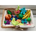 Making a basket of fruit for Grandma!