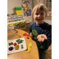 Making playdough food for grandma
