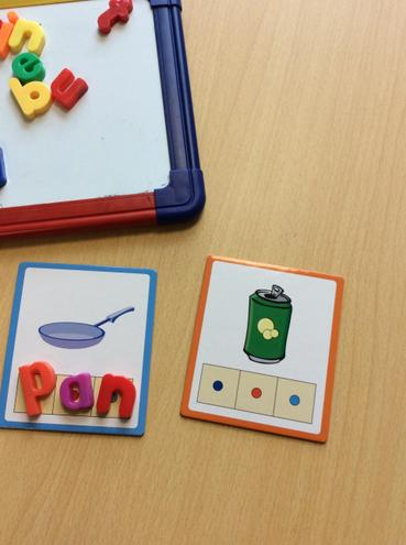 We use magnetic letter to make up simple CVC words.