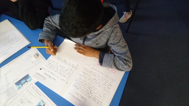 Ibrahim writing a story