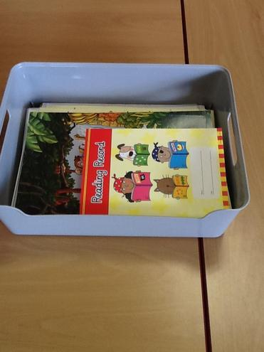 We keep our reading books in a tray on our tables.