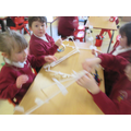 We worked in teams to create straw houses from the story The 3 Little Pigs.