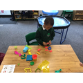 Practising our fine motor by using the Play-Doh!