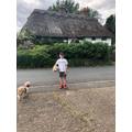 Harry spotted a thatched roof house on his walk