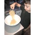 Harry making chocolate rice crispies