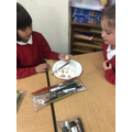 Cutting up boiled eggs to represent the layers of the earth.