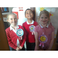 CHEERFUL CANDIDATES WITH CHEERFUL ROSETTES