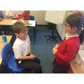 Children practiced their oracy by interviewing one another.