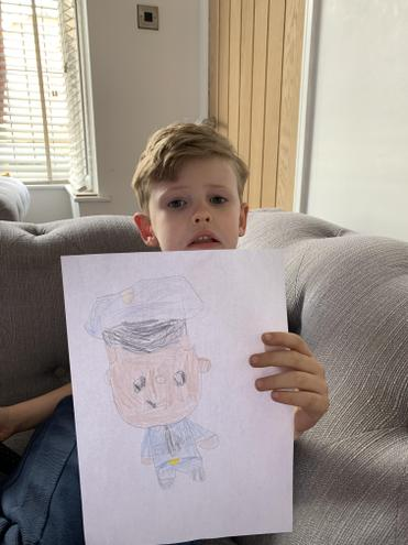 Jacob drew what he wants to be. 👮🏻‍♂️