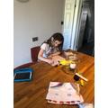 Tabitha writing letters.