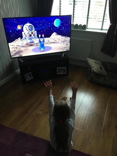 Jasmine is enjoying Space yoga.