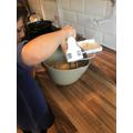 Practising measuring skills while baking... yum!
