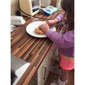 Amelie is very helpful making her own lunch.