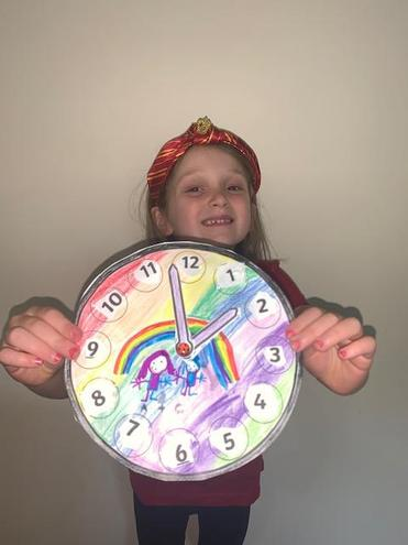 Amelia decorated her clock with her and Charlie🕐