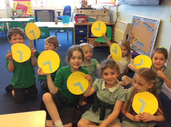 Year 1 telling the time on their handmade clocks