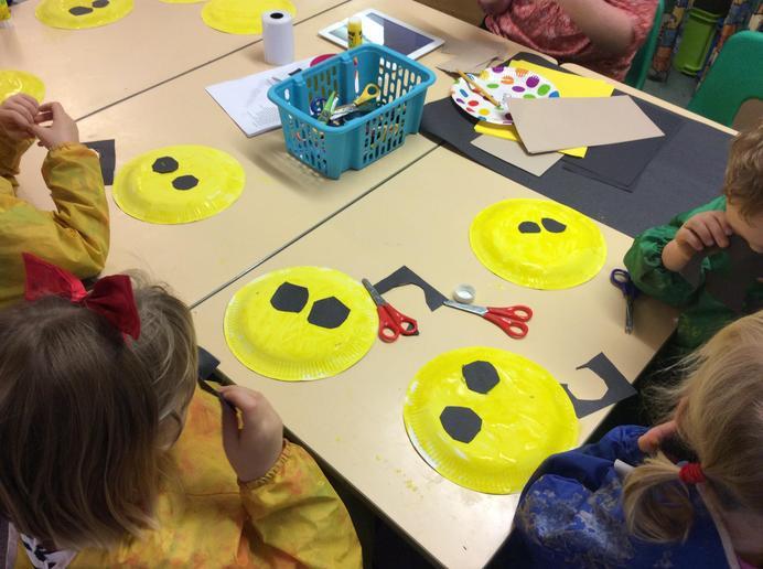 Making lion masks in Infant 1