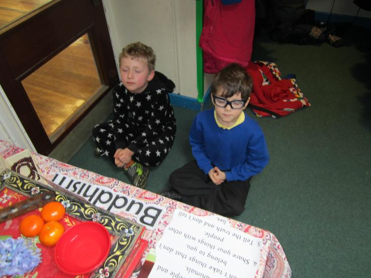 Liam and Cyrus choosing to meditate quietly.