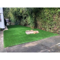 The new artificial grass area - great for all weather play.