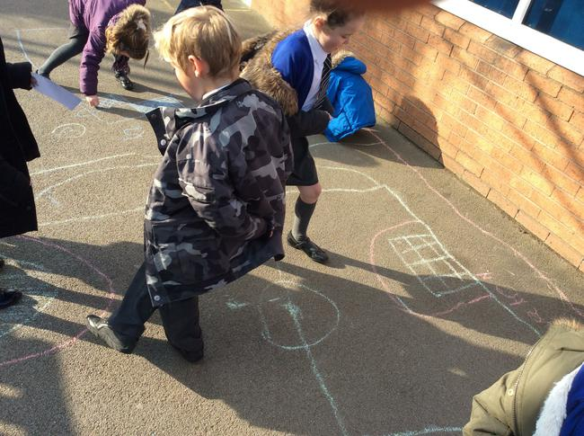 The children drew their own football pitch.