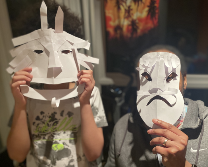 Brogan's mask, inspired by Greek theatre. Love the horns!