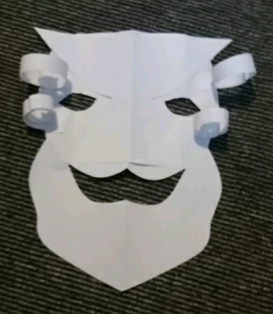 Brogan's mask, inspired by Greek theatre. Love the curly hair!