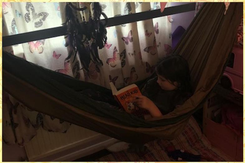Reading in comfort...good work Maddie