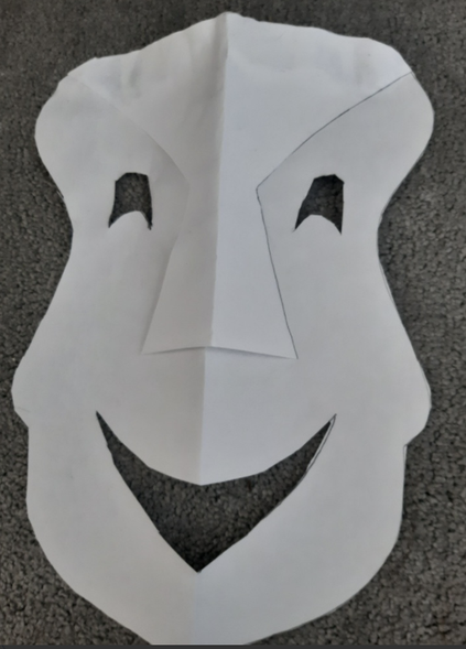 Chloe's mask, inspired by Greek theatre. Love the expression on his face!