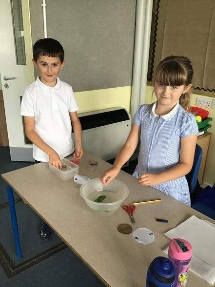 Calum and Freya creating their compass