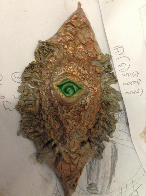 Painted clay dragon eye