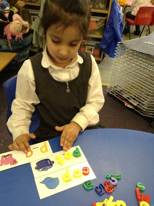 Making words with magnetic letters.