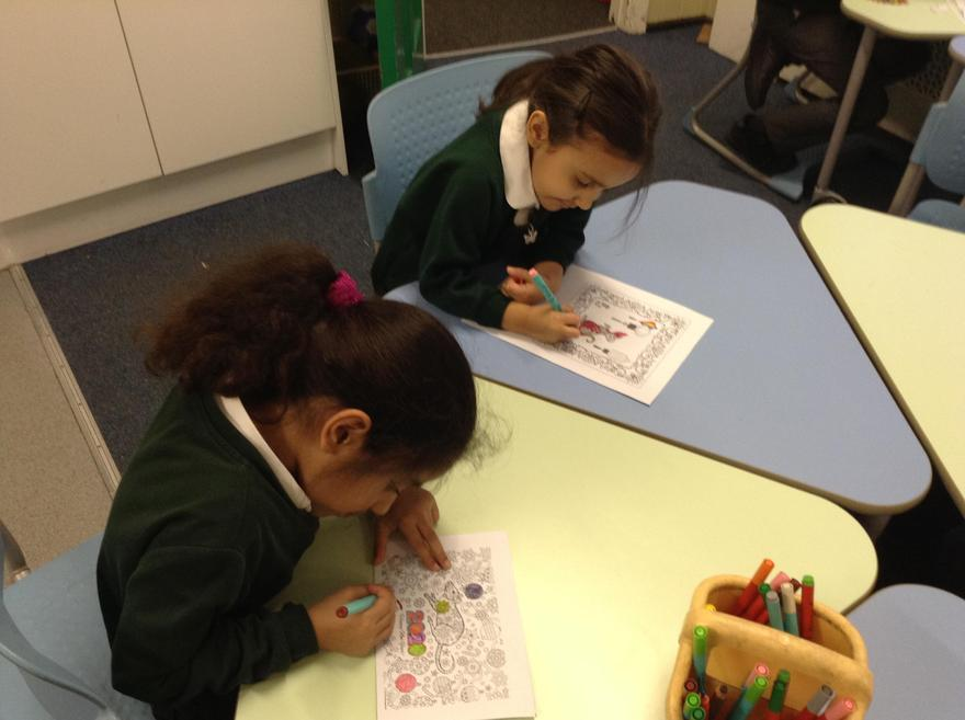 We are colouring pictures.