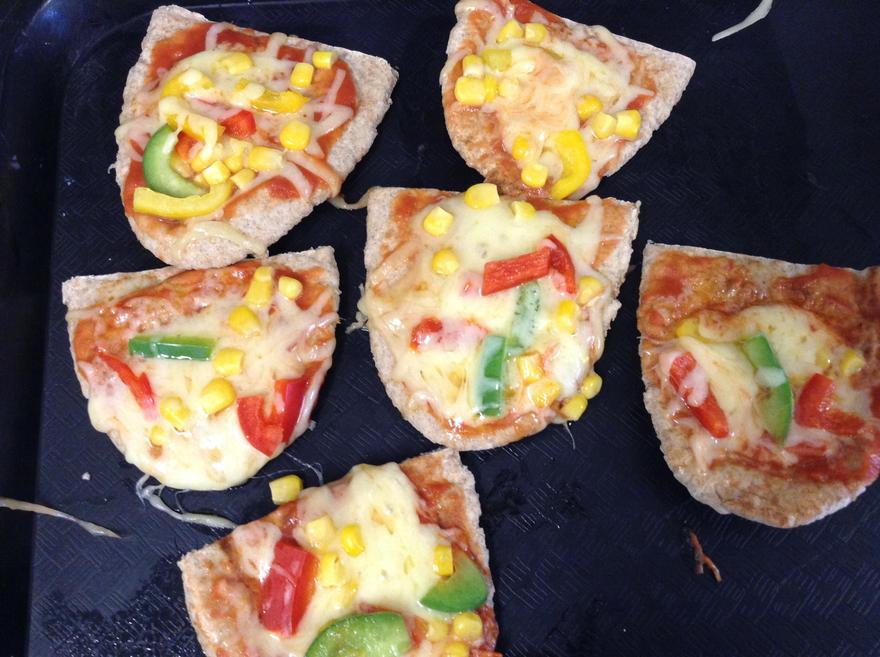 Look at our delicious pizza.