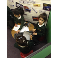 Writing down telephone messages.