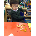 Matching the numeral to the number of candles.