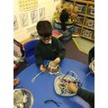 Pushing pipe cleaners into a colander was tricky.