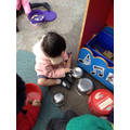 Making different sounds using found objects.