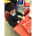 Practising our scissor skills.